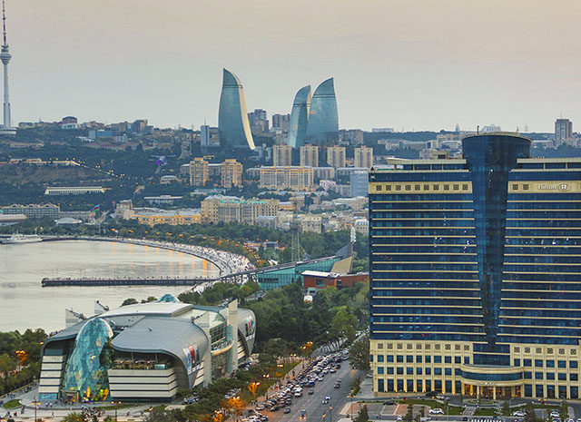 azerbaijan-baku-flame-tele-architecture-avenue-bay-cars-city-downtown-hilton-skyline-sunset-touristic-towers-travel