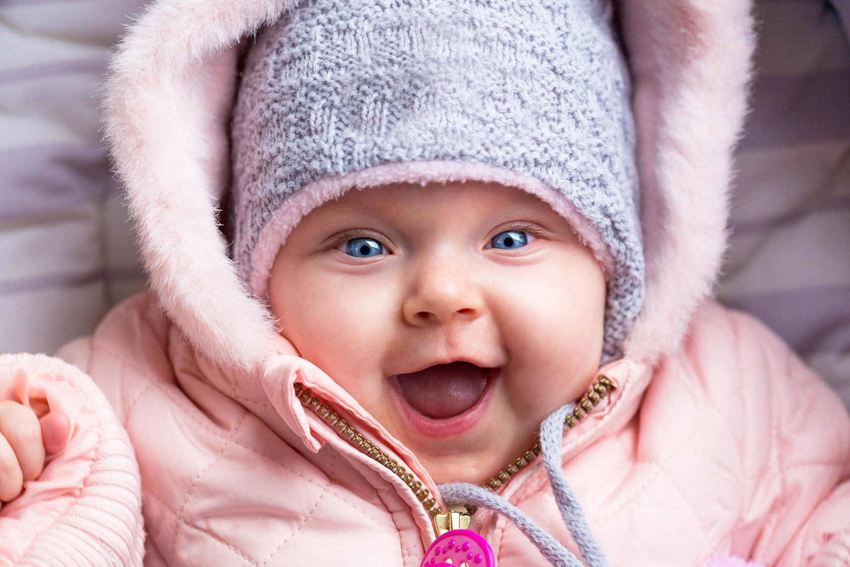 portrait-of-baby-girl-in-winter-jacket-and-hat