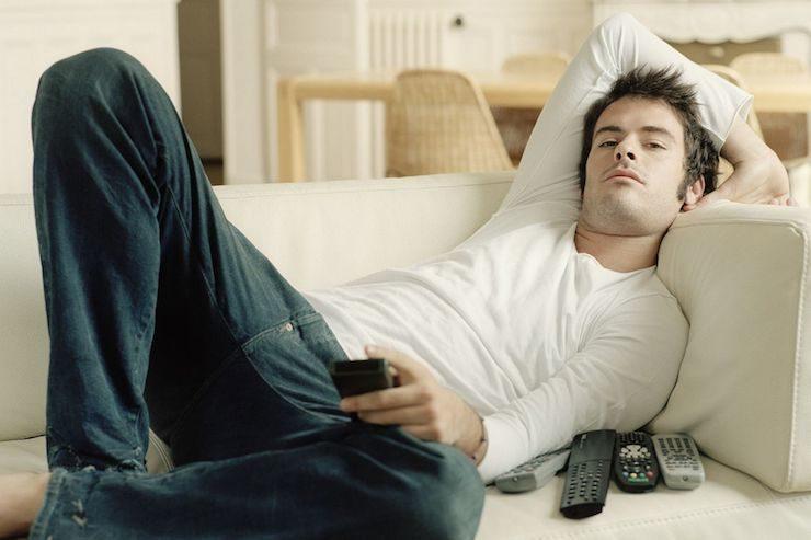 man-relaxing-on-sofa-9339812