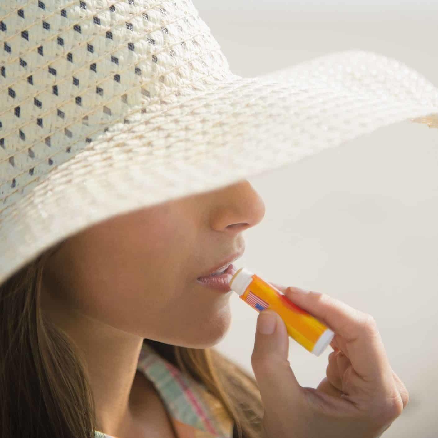 caucasian-woman-applying-sunscreen-lip-balm-at-royalty-free-image-526295481-1557352171-e1592832970743-1049607