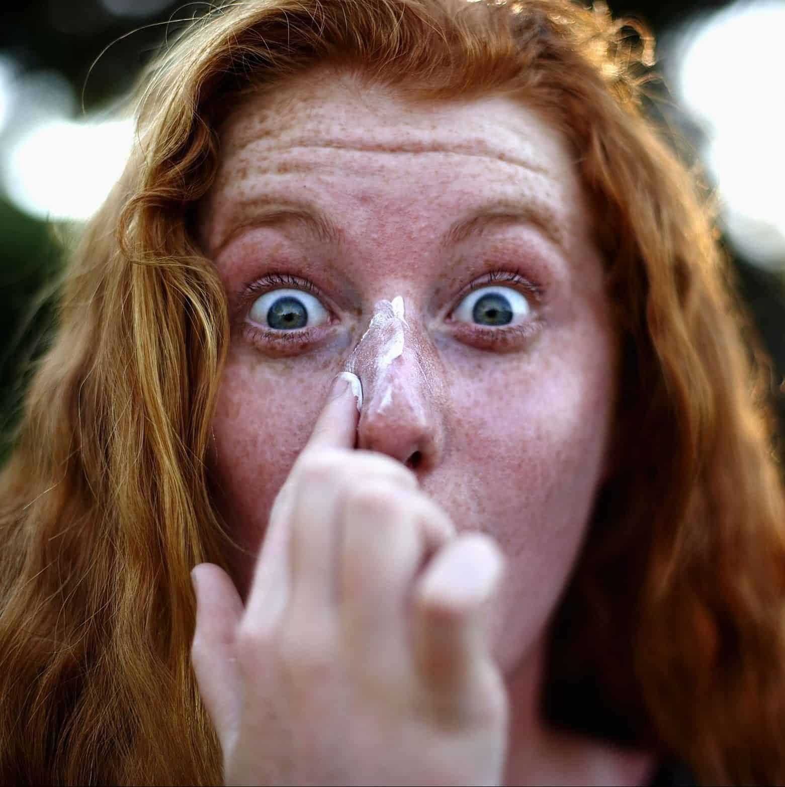 young-woman-putting-sunscreen-on-nose-5c243a4746e0fb0001e76aad-e1592832498960-1766710
